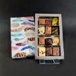 12 luxe bonbons (veertjes motief deksel zilver interieur)