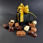 12 Luxe bonbons in kubus doosje goudenstrik